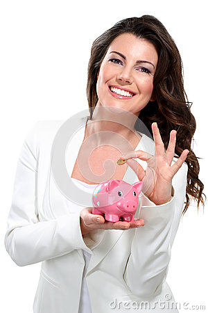 Young beautiful woman standing with piggy bank mon