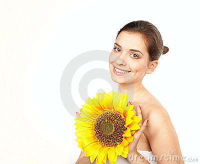Young beautiful woman with sunflower