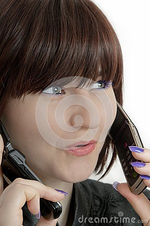 Young beautiful woman using call two phones