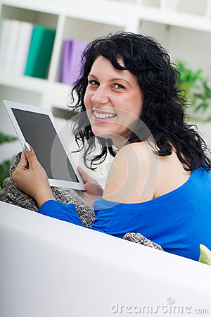 Young beautiful woman using digital tablet