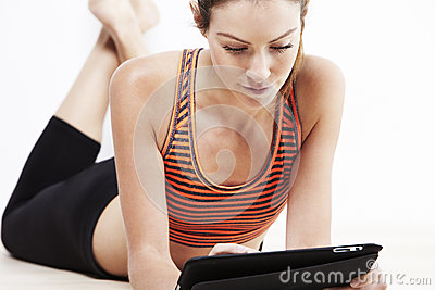Young beautiful woman using a tablet after workout Stock Photo