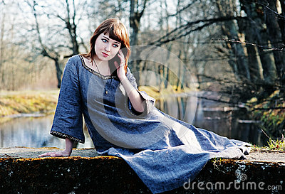 Young beautiful woman in vintage dress