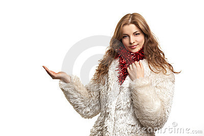 Young beautiful woman in white fur coat