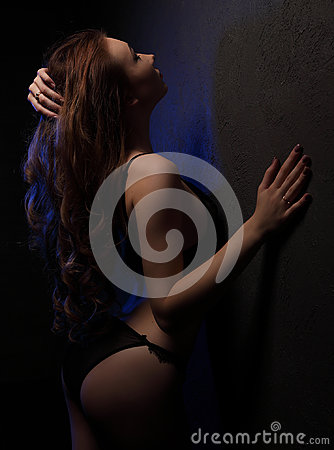 Free Young Beautiful Woman With Curls In Sensual Black Lingerie, Lighted With Blue In Studio Near Wall, Shoulder And Hair In L Royalty Free Stock Photos - 96618408
