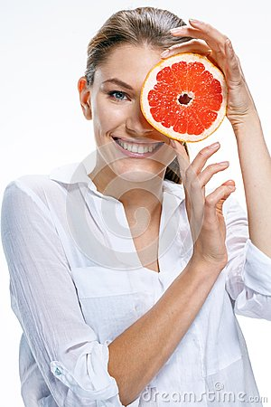Free Young Beautiful Woman With The Slice Of Grapefruit In Front Of Her Eye  On White Background Royalty Free Stock Photos - 32387108