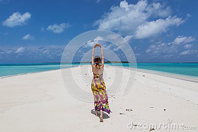 Young beautiful women on the sunny tropical beach