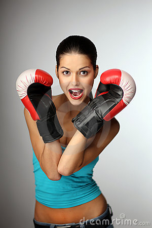 Young beautiful women wiht boxing gloves.