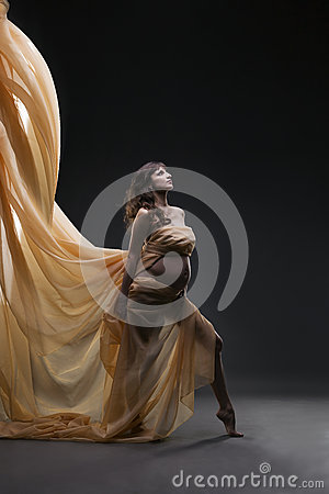 Free Young Beauty And Sexy Caucasian Pregnant Woman With Yellow Silk On Gray Studio Background Stock Photography - 69016382