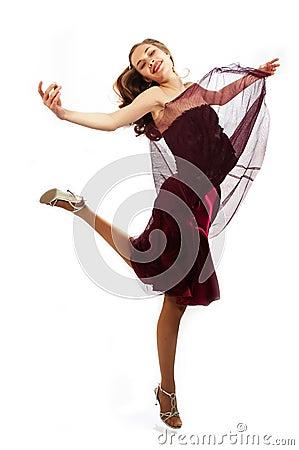 Young beauty girl is dancing