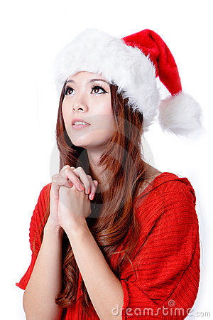 Young Beauty Girl wish with christmas hat