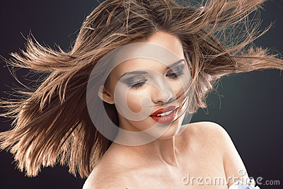 Young beauty model with blowing hair.