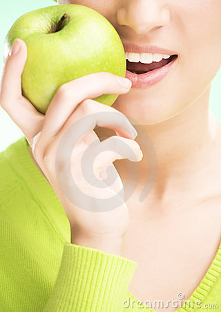 Young beauty woman with apple