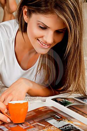 Young beauty woman with a cup of coffee