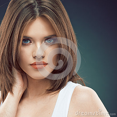 Young beauty woman face. Long Hair