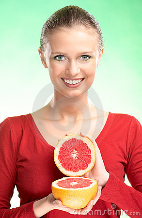 Young beauty woman with grapefruit