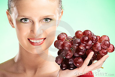 Young beauty woman with grapes
