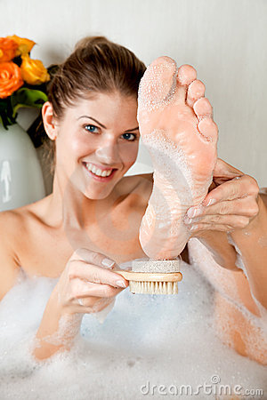 Free Young Beauty Woman In The Bath Washing Her Foot Royalty Free Stock Photography - 13537977