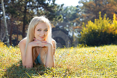 Young beauty woman in park