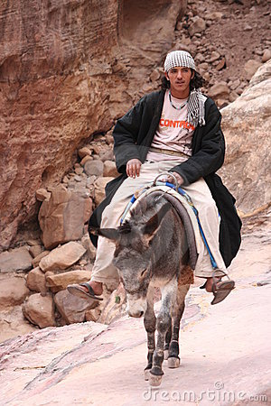 Young Bedouin riding his donkey Editorial Photo