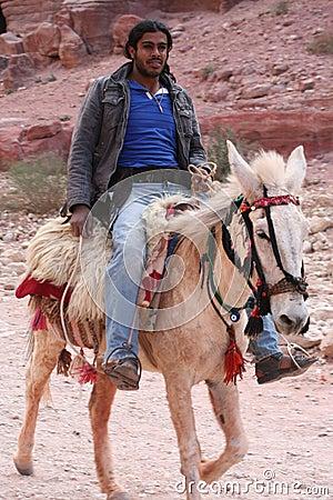 Young Bedouin riding horse Editorial Stock Photo