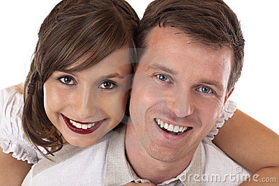 Young, beloved, happy couple smiles at camera