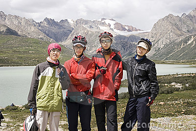 Young bicycle men in nature