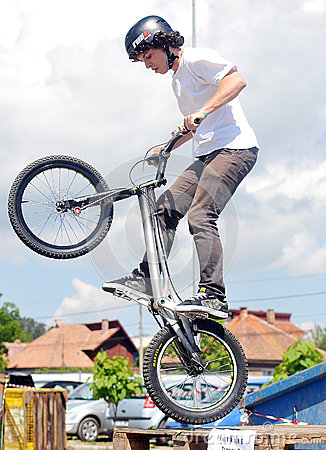 Young biker boy does tricks in the air Editorial Photography