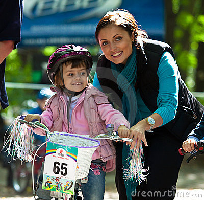 Young biker girl on child bicycle competition. Editorial Image
