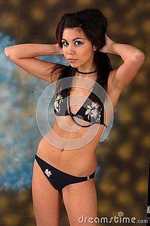 Young bikini model posing
