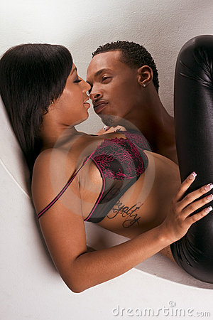 Young black couple Man and woman in love kissing