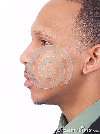 Young black man closeup profile portrait