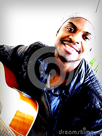 Free Young Black Man Playing Guitar Royalty Free Stock Photos - 28048638