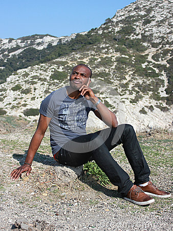 Young black man thinking, outdoor
