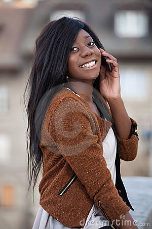 Young black teenage girl using a mobile phone