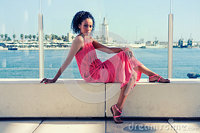 Young black woman, afro hairstyle, in the harbour