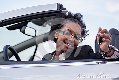 Young black woman driver holding car keys
