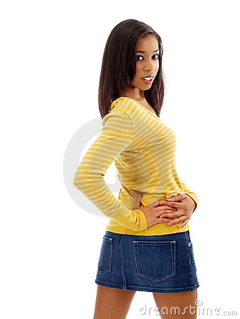 Young black woman in jeans skirt from behind