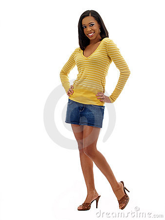 Young black woman in jeans skirt and yellow top