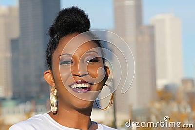 young black woman with large hoop earrings tasteful