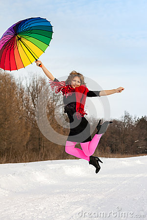 Woman with color umbrella in winter