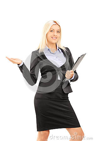 Young blond businesswoman holding a clipboard and gesturing with