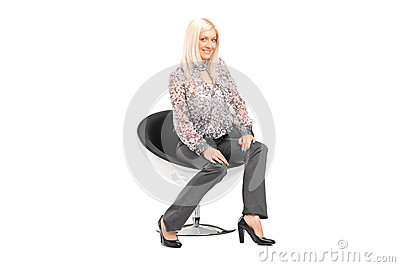 Young blond female sitting on a chair