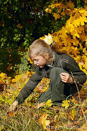 Young blond girl in an autumn