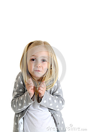 Young blond girl with funny expression shrugging shoulders