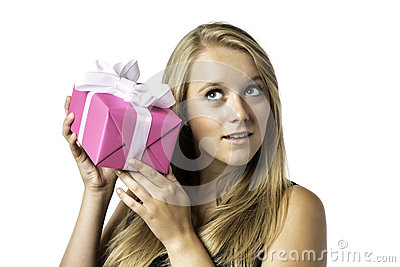 Young blond girl listens to a gift