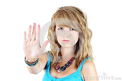Young blond girl making STOP or NO gesture