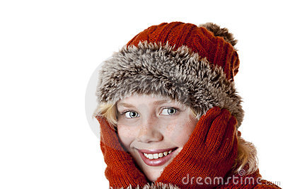 Young blond girl with winter cap and gloves.