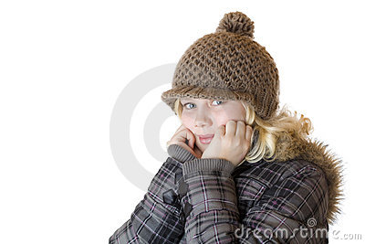 Young blond girl with winter cap and jacket