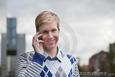 Young blond man with cellphone