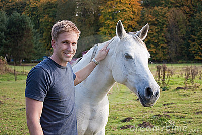 Young Blond Man with White Horse